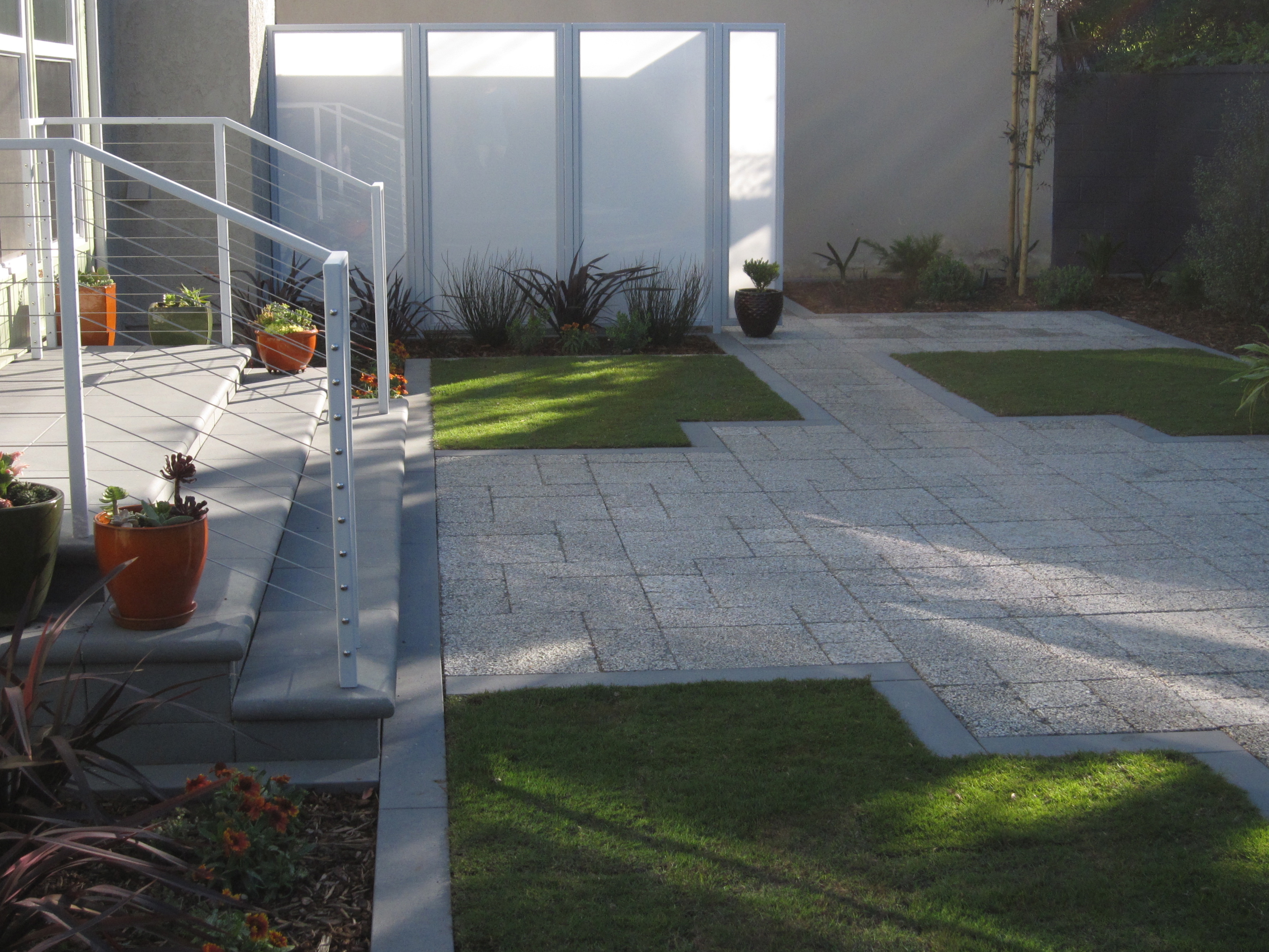 Courtyard softly illuminated at completion of planting in autumn 2012